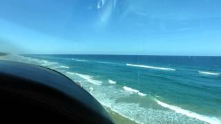 Cessna 205 takeoff on the beach in Fraser Island