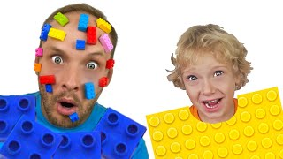 Lev and dad are playing big LEGO