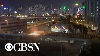 Hong Kong protesters set fire to bridges at university