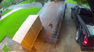 Sudden Lightning Strike Sends Two Grown-ups Running In Fear - Security Cam Footage