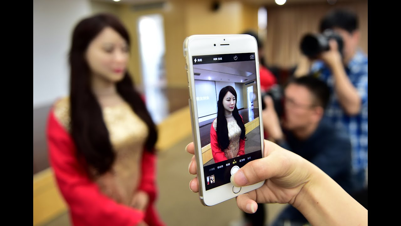 china unveils first interactive robot   youtube
