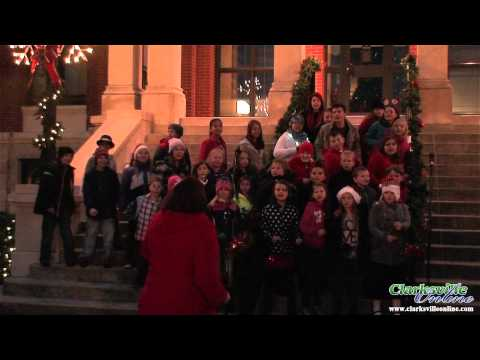 Montgomery Central Elementary School Honor Choir sings on the Montgomery County Court House steps