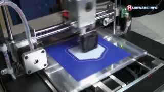 fdm 3d printer printing a gopro cage and mini eiffel tower