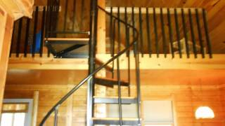 Spiral Stairs Leading Up To A Loft Bedroom W/queen Size Bed