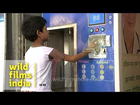 Young boy uses Swajal water vending machine: Rs. 1 per litre