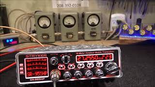 The Skull's Radio 955 with a strap on amp