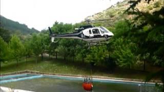 Helicóptero cargando agua en Navalacruz
