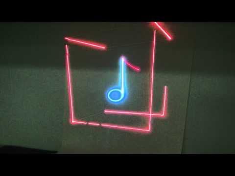 Laser 3d cube rotate around 2d musical note.