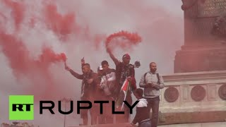 RAW: Pro-Palestinian rally in Paris turns ugly, protesters clash with police(Thousands marched in Paris on Sunday to protest Israel's Operation Protective Edge. The demonstration turned violent when some protesters started throwing ..., 2014-07-14T14:44:48.000Z)