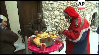 Impoverished Bosnians struggle to reach soup kitchens in snow