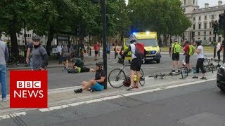 Westminster car crash: 'One of the Cyclists got up and started to chase the Car' - BBC News