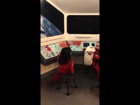 Charlee plays spaceship at museum