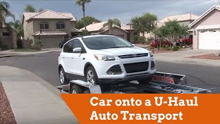 how to load a car onto a u haul auto transport