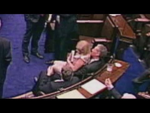 Irish MP pulls female MP onto his lap in Parliament debate