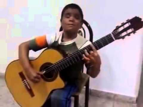 Дети таланты. Божественное исполнение мальчиком титаника на гитаре.