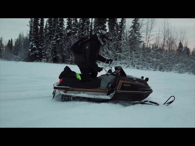 riding snowmobiles and flying drones in Alaska