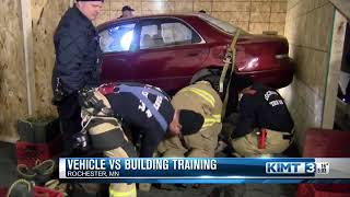 Firefighters train on a building vs vehicle crash