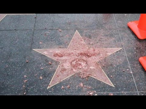 Man destroys Donald Trump's Hollywood star with sledgehammer