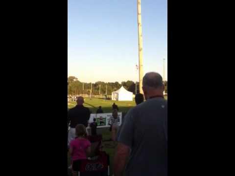 Morgan cox sings at SBEC football game