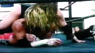 CM Punk Bites Rope to Break Submission