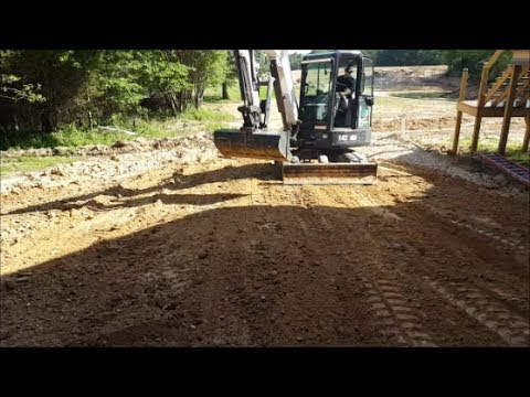 Bobcat E42 Excavator Grading New Home fill with 52 inch ditch bucket