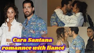 Cara Santana packs on the PDA with fiancé Jesse Metcalfe after enjoying a romantic dinner date