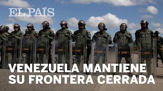 Maduro cierra la frontera con Brasil en vísperas de la entrada de ayuda humanitaria anunciada por...