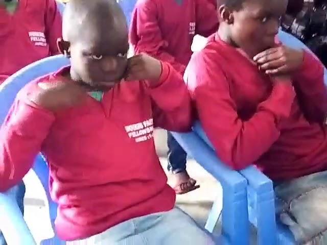 Bro Joseph Teaching Children Story of Jonah - Kibera Slum Fellowship