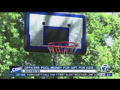 Police officers buy kids new basketball hoop