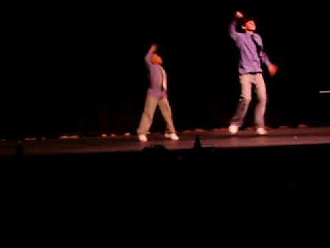 Ryan Haskett and student hiphop duet