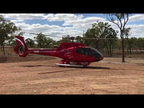 Airbus EC130T2 Helicopter Lifting Off From Australia Outback