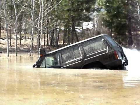 modified jeep cherokee snorkels very deep water and floats