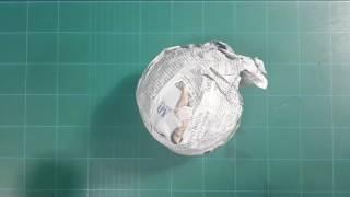 Making Newspaper Ball on Green Cutting Mat