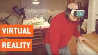 Dad Tries Samsung Virtual Reality Goggles