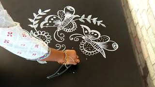Easy rangoli designs..butterflies..simple rangoli..6 to 2 dots