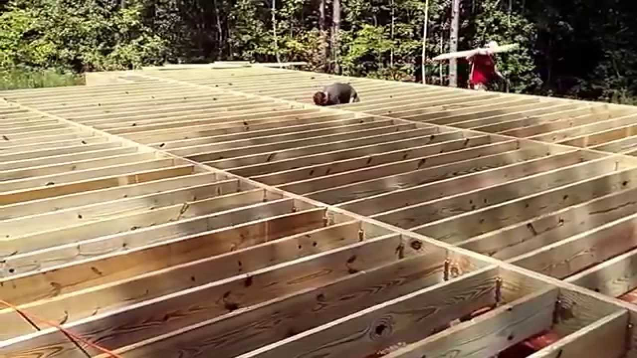 Floor joist cabin in the woods youtube for How to build a cabin floor