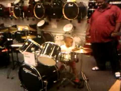 KING ZION 3 YEARS OLD ON THE DRUMS PART 2!.3gp