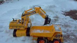 RC Excavator Digger digging snow in Bulgaria