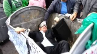Ukrainian Politician Thrown into Trash: Pro-Yanukovych MP manhandled outside parliament