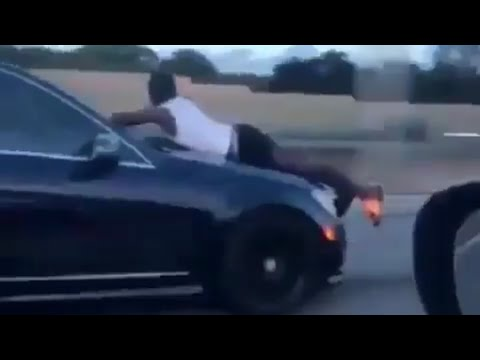Man riding outside of car hood on i95 highway - Miami