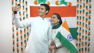 Young Indian teenagers clicking selfie together on Republic Day - National flag background