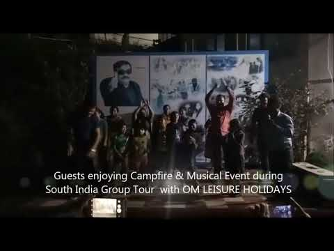 Guests enjoying Campfire and Musical Event at hotel during South India Group Tour