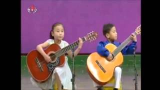 North Korean Kids  playing guitar amazing skills - 2013 song