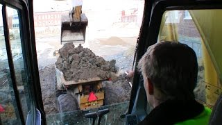 Loading Hydrema 912D Dumpers In A Tight Space With The Komatsu PC210 Excavator