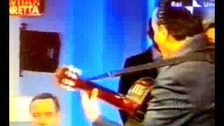 mino reitano canta con bossi suggerendo le parti