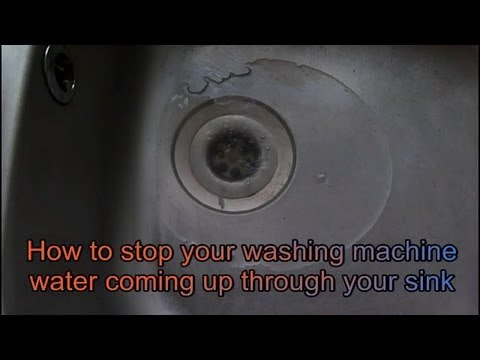 washing machine drain backs up into kitchen sink