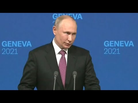 Putin chuckles, deflects when asked about Navalny