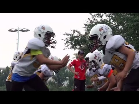 Young Chinese tackle single child syndrome with American football