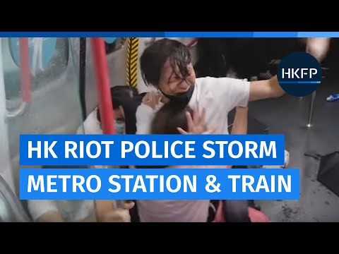 Hong Kong riot police & tactical officers storm metro train and beat, arrest protesters