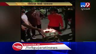 Youths publicly celebrate birthday with liquor bottle on cake in Surat, video goes viral| TV9News